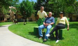 Residents on Bench in Lawn